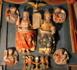 Le retable de la Trinité , XVIe siècle (Église de Saint-Aignan).  Sur le fond d'une grande draperie retenue par une couronne, le Père et le Fils, surplombés par l'Esprit-Saint tiennent un tableau en forme d'arche où sont inscrits les mots SANTA TRINITAS UNUS DEUS. Aux quatre coins de cette composition trinitaire, des médaillons présentent les évangélistes et leur attribut : saint Marc et son lion, saint Matthieu et l'ange, saint Luc et le taureau, saint Jean et l'aigle. En dessous, deux anges porteurs de bougeoir présentent le calice et l'hostie de l'Eucharistie. (Crédits photo : Jean-Yves Cordier )