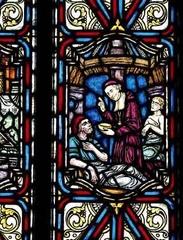 Saint François de Laval servant les pauvres (Vitrail de la Salle des prêtres du Pavillon Jean-Olivier Briand du Séminaire de Québec)